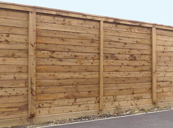 pressure treated wooden fence